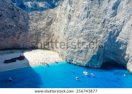 Top view on Navagio bay. Summer coastline view (Greece, Zakynthos, Ionian Sea). All peoples unrecognizable. - stock photo