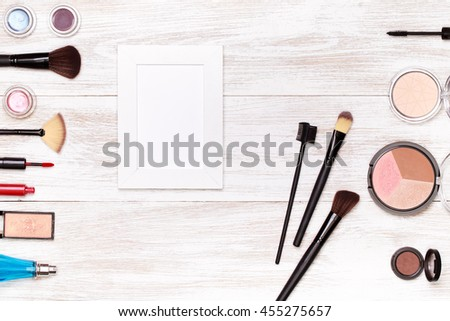 Top view on set of cosmetics for professional make-up  on wooden background - stock photo