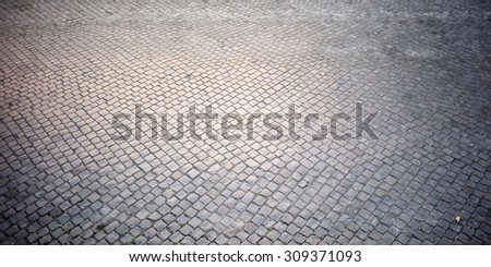 Top view on texture background of straight flat stony brick grey paving stone street road outdoor copyspace, horizontal picture - stock photo