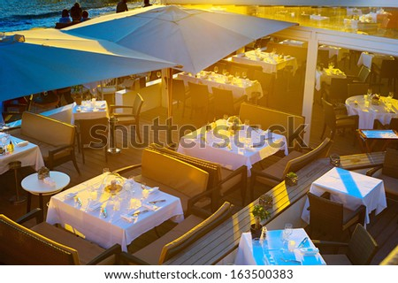 Top view on the restaurant in sunset lights, Cannes  - stock photo