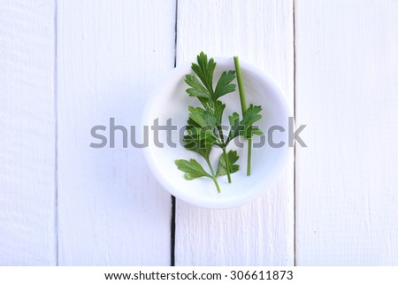 Top view parsley in bowl on white background - stock photo
