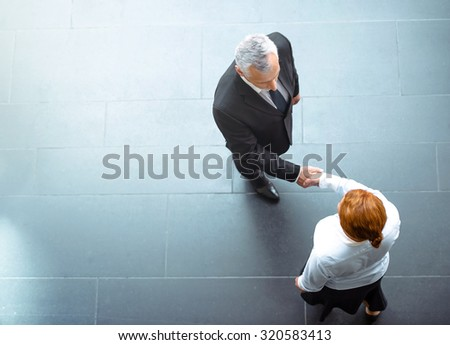 Top view photo of creative business people. Business people shaking hands while meeting - stock photo