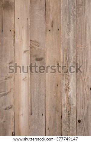Top View Photo of Naturally Aged, Rough textured Rustic dull Brown Cedar Wood Boards for Backgrounds and Templates with Blank Room or Space for your Design, Words, Text or Copy.  Vertical rectangle - stock photo