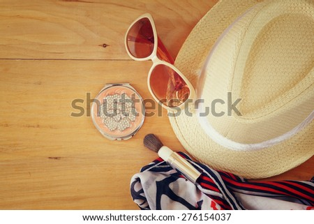 top view photo of woman accessories , different objects on wooden background  - stock photo