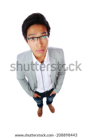 Top view portrait of a handsome asian man over white background - stock photo