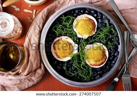 top view portrait of spanish tapas baked scallops - stock photo