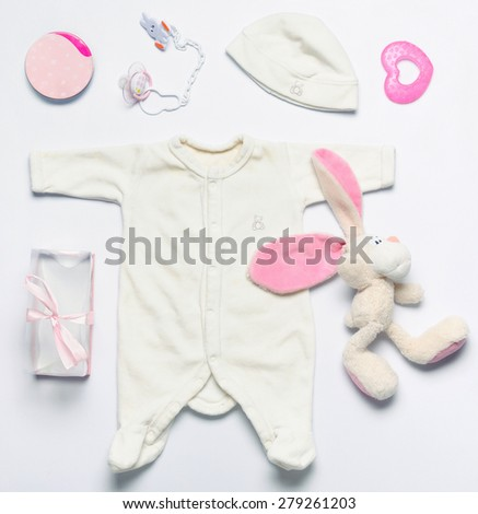 top view set of fashion trendy stuff and toys for newborn baby girl, baby fashion concept  - stock photo