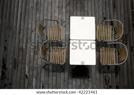 Top view shot of a smoking area with some tables and chairs in a cafe. - stock photo