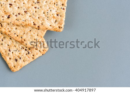 Top view shot / picture of three slices of dietary whole grain / crispbread crackers. Isolated on grey background with clipping path included. Background color / content can be changed as desired. - stock photo