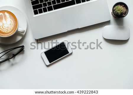 top view with copy space Office white desk table with computer,smart phone supplies, coffee cup. - stock photo