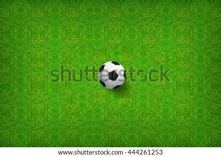 Top views of soccer ball on green grass of soccer field background. - stock photo