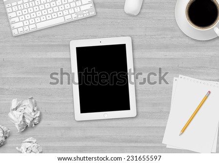 Top white wood office table with cup of coffee, paper, pencil, tablet and keyboard - stock photo