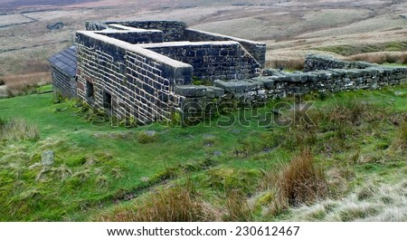 Top Withens, Bronte country West Yorkshire, the ruins of the desolate farm house that is allegedly the location for the Earnshaw home in Emily Bronte's Wuthering Heights  famous gothic novel  - stock photo
