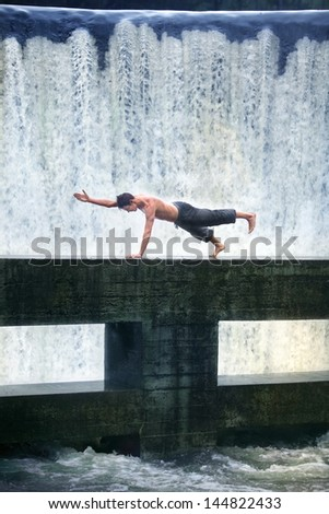 topless fit man's pilates in nature - stock photo