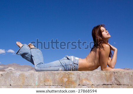 Topless girl in blue jeans - stock photo