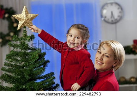 Topping the Christmas tree - stock photo