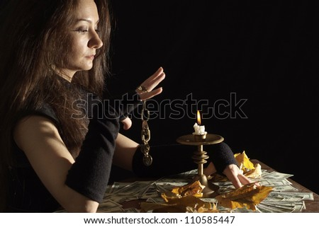 Tops girl as a witch on a dark background - stock photo