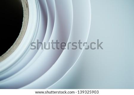Topshot macro Paper roll in a printshop - stock photo
