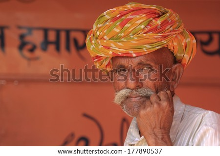 TORDI GARH, INDIA � MARCH 1: An unidentified man inside the village of Tordi Garh, Rajasthan, Northern India on March 1, 2012. The fort and palace are occupied by BH. Hemendra Singh and his family. - stock photo