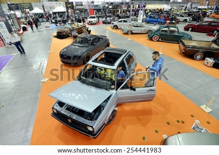 TORINO, ITALY - FEBRUARY 15, 2015: A Exposition of different and colored tuned cars on display at Expo Tuning Torino. Special edition of Volkswagen Golf in Torino business place on February 15, 2015 - stock photo