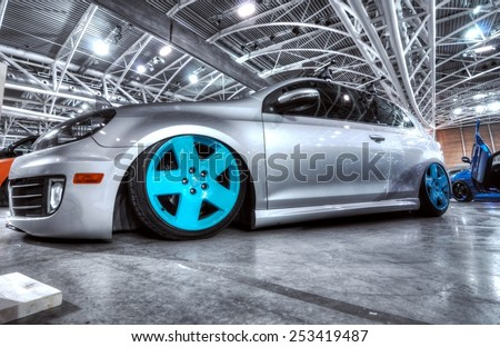 TORINO, ITALY - FEBRUARY 15, 2015: New generation of Golf tuned car exposed at Expo Tuning Torino with big and colored custom wheels inside a motor show business place on February 15, 2015 - stock photo