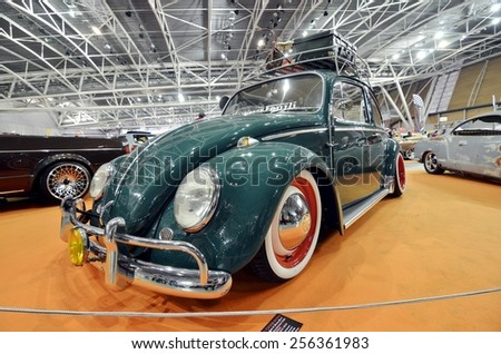 TORINO, ITALY - FEBRUARY 15, 2015: Special edition of tuned and lowered vintage Volkswagen Beetle with roof rack on display at Expo Tuning Torino business place on February 15, 2015 - stock photo