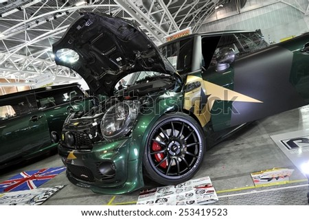 TORINO, ITALY - FEBRUARY 15, 2015: special version of Mini Cooper S John Cooper Works tuned car with carbon fiber bonnet exposed at Expo Tuning Torino on Torino business place on February 15, 2015 - stock photo