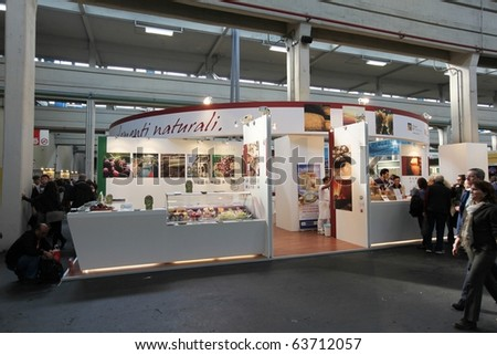 TORINO, ITALY - OCT. 24: People visiting stands at Salone del Gusto, international fair of tastes and slow food October 24, 2010 in Torino, Italy. - stock photo