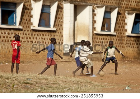 TORIT, SOUTH SUDAN- FEBRUARY 20, 2013: Unidentified children play football in a village in South Sudan - stock photo
