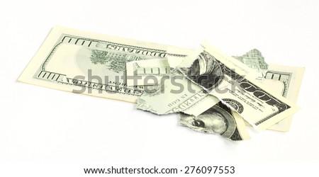 torn a hundred dollar bill - stock photo