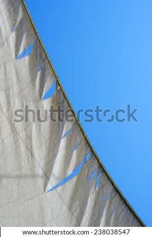torn and weathered white  awning. - stock photo