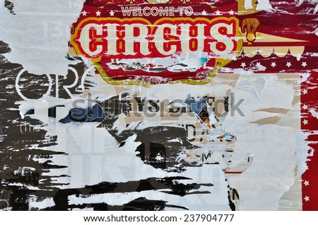 Torn billboard posters abstract grungy background texture. - stock photo