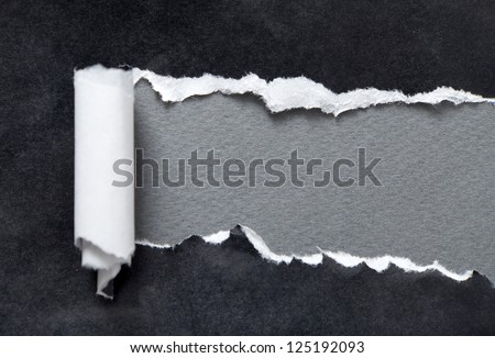Torn black parchment with grey space for your message - stock photo