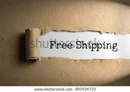 Torn brown paper with Free Shipping words - stock photo