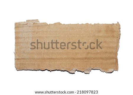 Torn cardboard piece on white background - stock photo