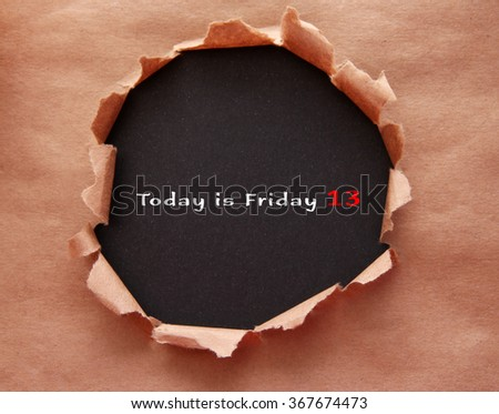 Torn craft paper with black background and text Today is Friday 13 - stock photo