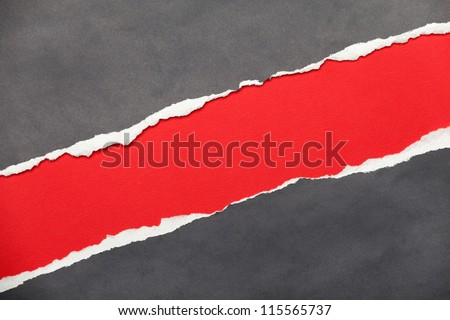 Torn edge textured paper with red space for your message - stock photo