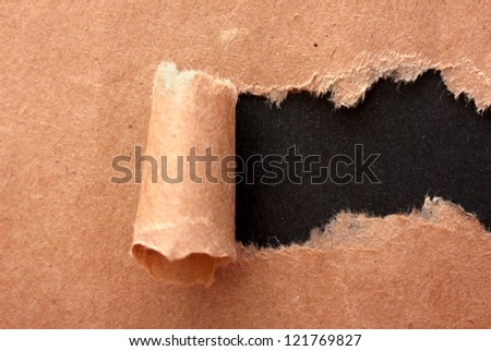 Torn kraft paper background - stock photo