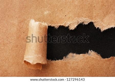 Torn kraft paper background - stock photo