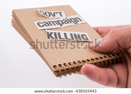 Torn Newspaper Title on a notebook - stock photo
