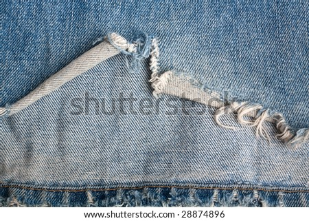 torn old blue jeans - stock photo