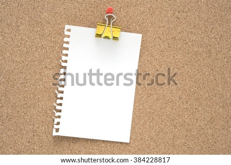 torn paper and fold back clipper on wood board - stock photo