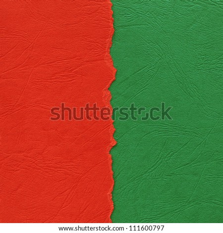 Torn paper background made of red and green vertical strips. - stock photo