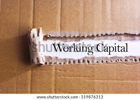 Torn paper box with word Working capital - stock photo
