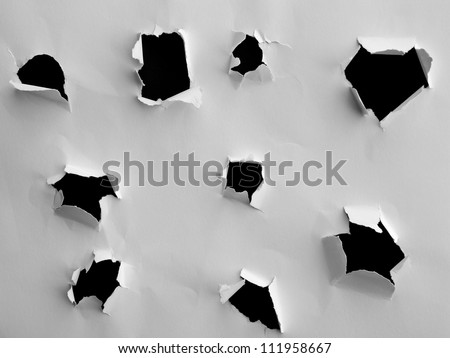 Torn paper holes and ripped edge textures - stock photo