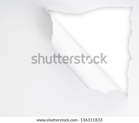 Torn paper sheet with an empty gap hole as a copyspace background - stock photo