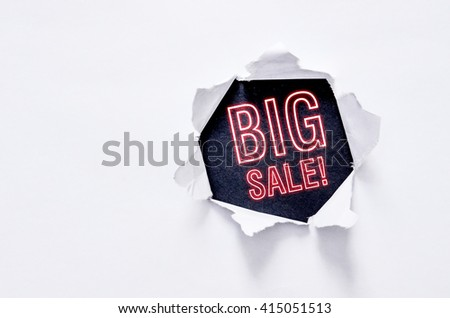 Torn paper with a word Big Sale! - stock photo