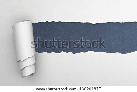 Torn paper with blue background - stock photo