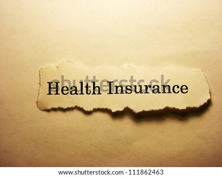 Torn paper with health insurance text. Health insurance concept. - stock photo