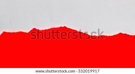 Torn paper with red background with space for text - stock photo